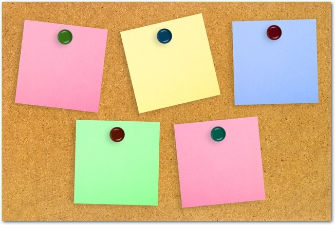 Colorful note paper on wood background